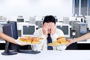 employee-being-offered-junkfood-500x334